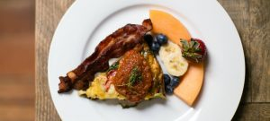 Fritatta with Roasted Pepper Sauce bacon and fruit